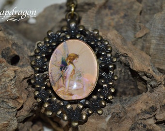 Fairytale fairy image pendant set in an antique floral tray setting with Figaro chain