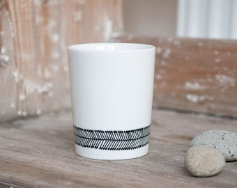 """Hand-painted cup """"somewhat angular"""", black and white"""