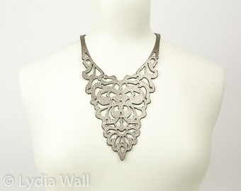 Laser cut leather necklace in Gold