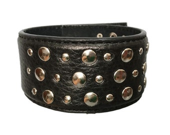 Black leather studded strap bracelet cuff wristband.  Black cuff with silver studs.