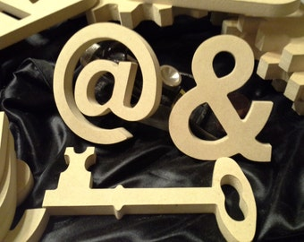 Decorative Symbols - At Sign - @ - snail, curl, strudel, whorl, and whirlpool
