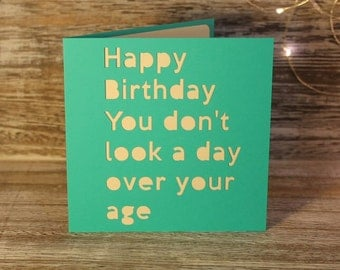 You don't look a day over your age - a papercut card
