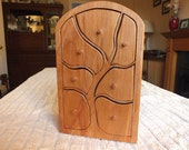 A tall seven drawer tree patterened chest in Scottish Beech with natural distinctive markings in the wood.