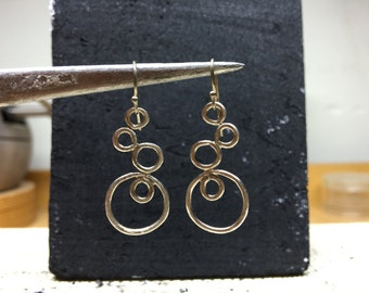 Brushed sterling silver INFINITY earrings.