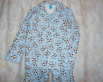 Boys Size  8 Pajama with black and white cows on blue background.