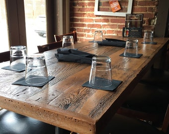 Dining table, reclaimed wood , pipe leg base