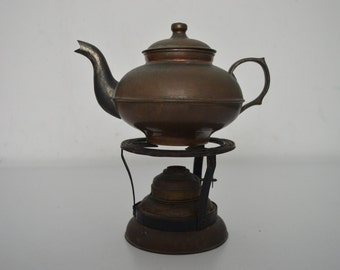 Small copper teapot with burner from field
