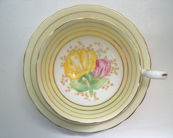 Antique 1930's Victoria  C & E Tea cup And Saucer, yellow tea cup set with pink and yellow flowers.,