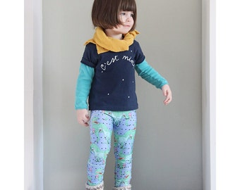 Blue leggings for children with drawings original of Dinosaurs and ice cream printed by sublimation on poly-spandex