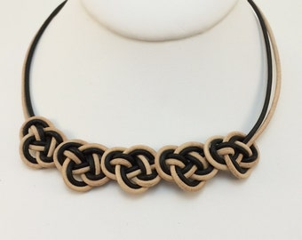 Chinese Double Coin necklace in neutral and black leather cord - with magnetic clasp
