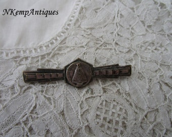 Religious brooch 1920's