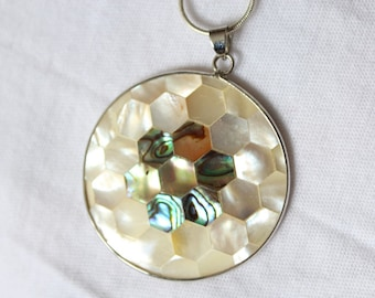 Necklace with large circular medallion in mother of Pearl and abalone, hexagonal pattern. Bee