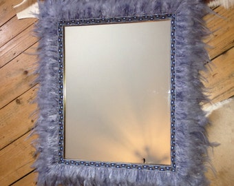 Mirror with grey feather trim