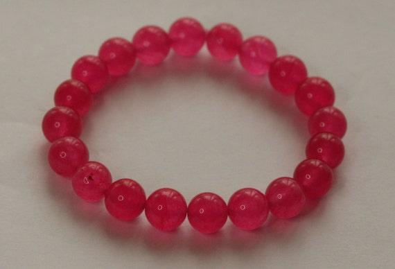 semi precious bright pink quartz elasticated gemstone bracelet