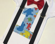 Sesame Street first birthday onesie with bow tie and suspenders