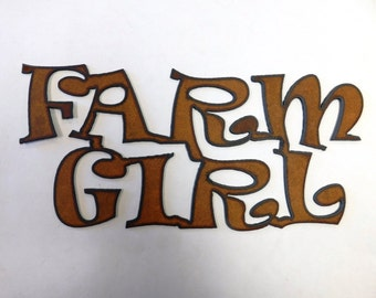 Farm Girl sign made out of rusted metal
