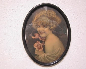 ROSES , A young girl with Pink Roses in an  Oval Metal  Frame  with glass  ** 1930s circa