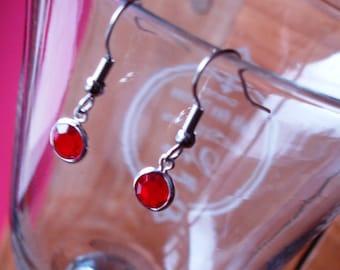 Red crystal ear rings !