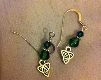 Green and silver pierced earrings with Celtic knot Triad charms.