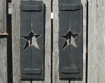 "Decorative rustic wood shutters with 1 star  in each. Two in a set 24"" high and 7"" wide, many colors and size's."