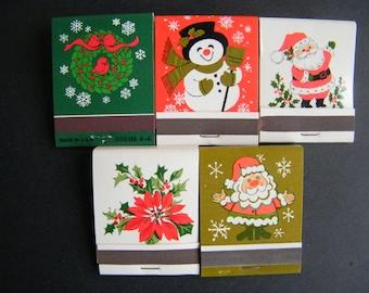 A set of five Vintage NOS Hallmark Christmas matchbooks matches Santa Clause Wreath and Holly Snowman Poinsettia