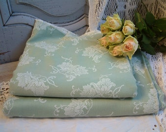 One piece of french vintage light green mattress ticking with white roses. French mattress ticking fabric for craft projects.