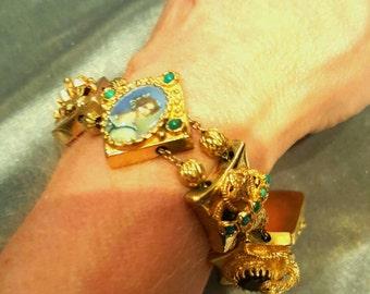 14K yellow gold slide style charm bracelet.