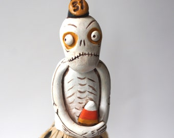 Halloween Skeleton with Skirt and Candy Corn folk art sculpture