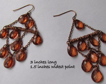 Trianglular cascade crystal hanging teardrops dewdrops charms wired waterfall earings. Distressed bronze.
