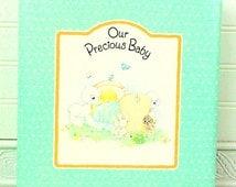 "Vintage Precious Moments Keepsake Album. ""Our Precious Baby"",  Green album with lambs on the cover, unused album"