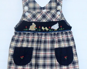 Vintage baby dress. tan and black jumper detailed with pockets and farm animals, no name sz 2T