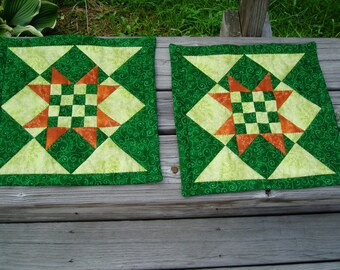 Hand quilted Forest Green and light green with orange star highlights, set of 2 place mats
