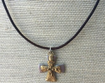 Gold cross over silver cross on brown leather necklace