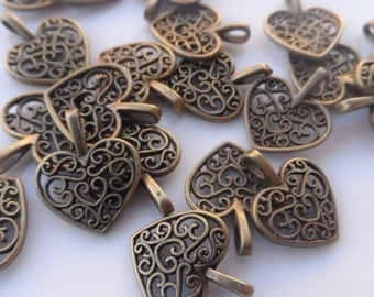 10 Charms  Hearts perforated. Color Antique Bronze 15x17mm