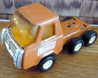 Vintage Buddy L metal truck with 3 axels.