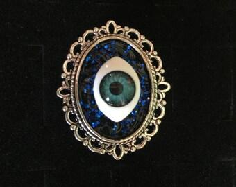 Blue eye ring.