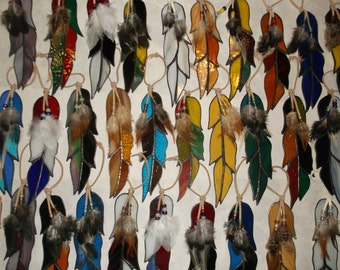 Beautiful stained glass feathers for your window or anywhere in your home. custom colors available.
