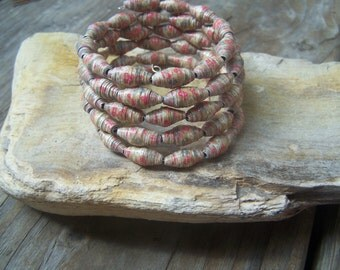 Recycled scrapbook paper , memory wire,  paper bead bracelet