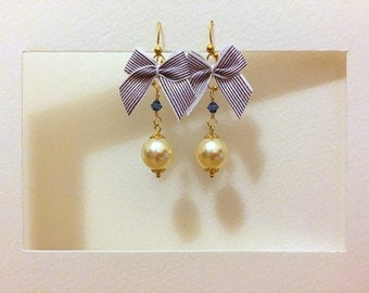 swinging earrings with violet and white bows