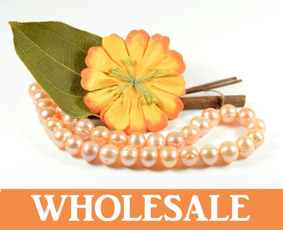 WHOLESALE 11mm - 12mm, large hole (2.5mm), genuine freshwater pearls, natuarl round, natural peach color - 34+ PCS per strand