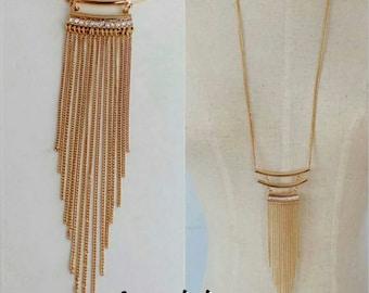 gold tassle necklace with rhinestone detail
