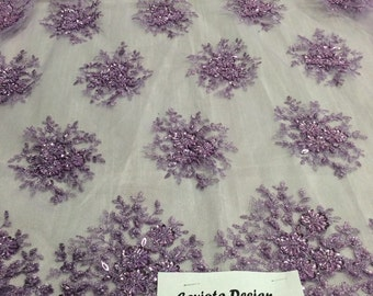 Lilac gaviota design embroider and beaded on a mesh lace. Wedding/Bridal/Prom/Nightgown fabric. Sold by the yard.