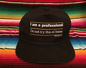 VTG 90s Black Snapback hat: I am a professional, Do not try this at home.
