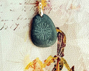 Hand engraved  beach stone pendant with ancient Baltic symbols