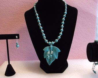 Turquoise Necklace with a Carved Leaf Pendant