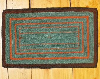 Primitive vintage geometric hooked rug