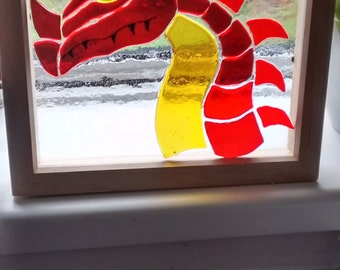 Fused glass dragon framed