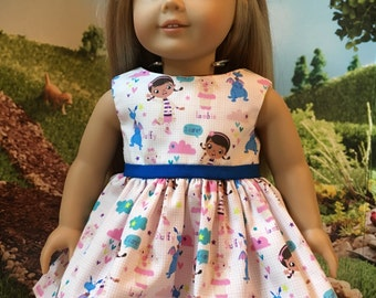 """18"""" doll dress. Fits dolls like AG, OG and others.  The fabric is doc mcstuffins.  She can match her Wellie Wisher sister!"""