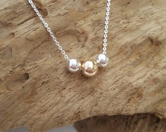Sterling silver necklace with 6mm 9ct gold and sterling silver focal beads