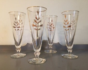 50% SALE *** Four+ Footed Pilsners with Gold Stylized Trees / Leaves and Gold Rim